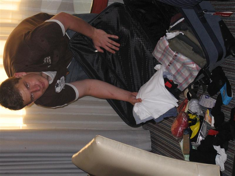 Whoops!  Adam gets excited as he unpacks for a night in LA.