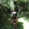 Jen stops to enjoy the flower-strewn path