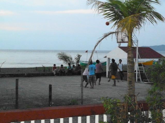 Locals playing basketball outside the resort