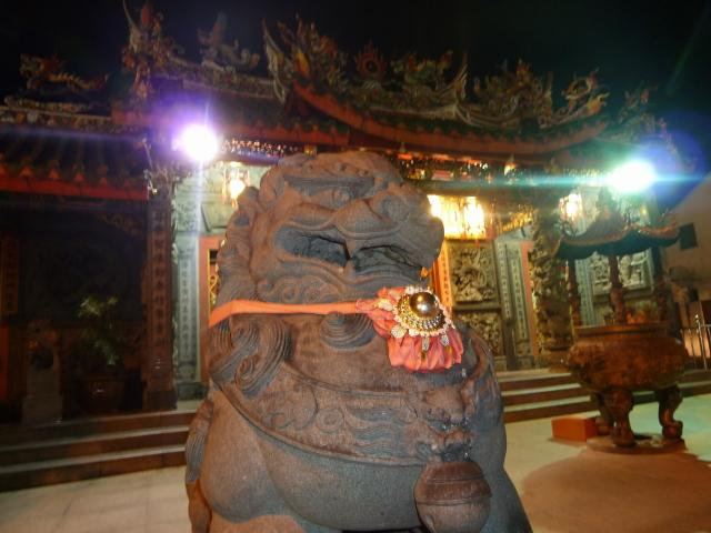 A statue outside a Chinese temple