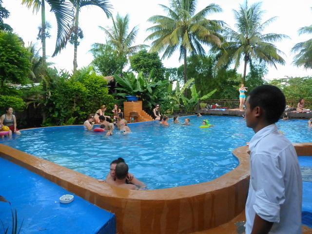Swimming pool full of tourists