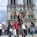 Marie jumping in front of Notre Dame