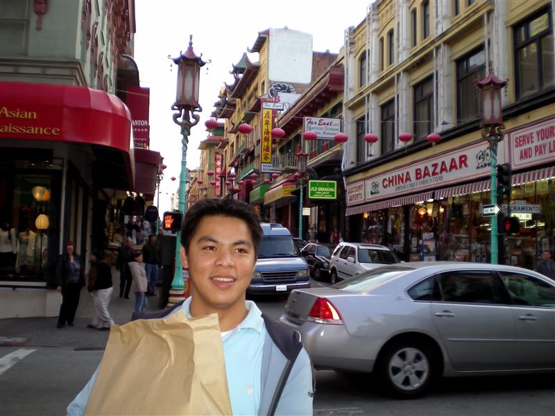 kanuto hugging our food bag in some street in chinatown
