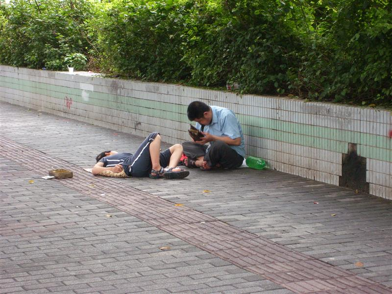 Begging for money ,with his child on his side  June 29 , 2008.