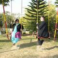 reekaji and Teresa on the farm swings