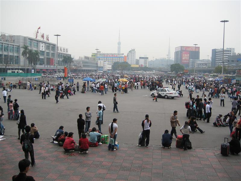 Guangzhou station, the station is in the far left, with all the folk outside!