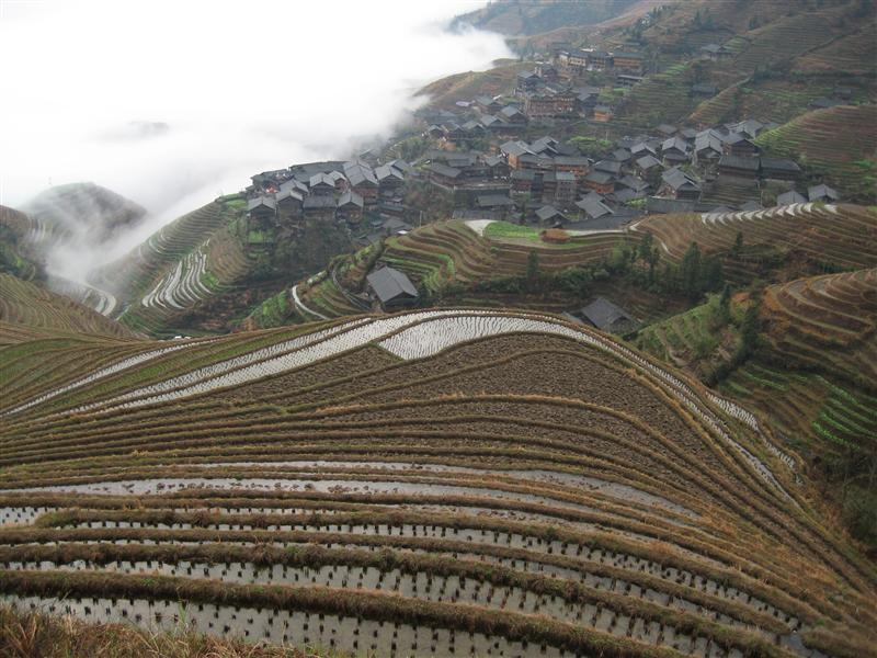 Ping an' village and the looming clouds