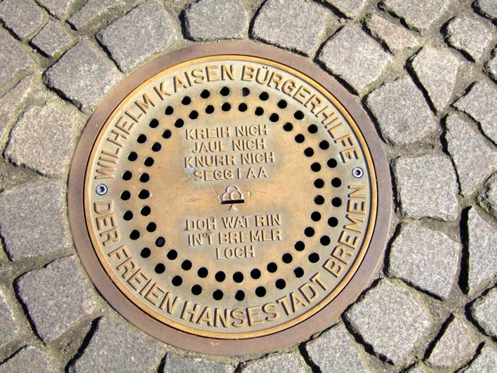 u put coin into this little slit on this manhole looking thing, and u can hear d sounds of d 4 musicians!