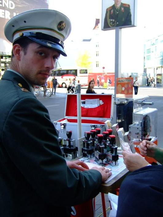 officer at Checkpoint Charlie who can give u all 15 original stamps of the checkpoint for €10