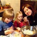 kids helping Eve with cooking