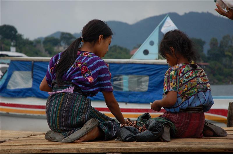 Mayan girls selling souvenirs at the dock