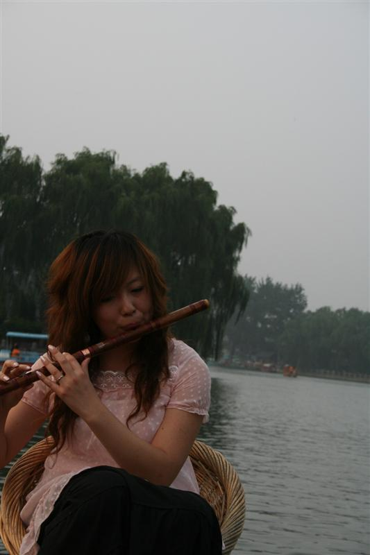 Lady playing flute on boat