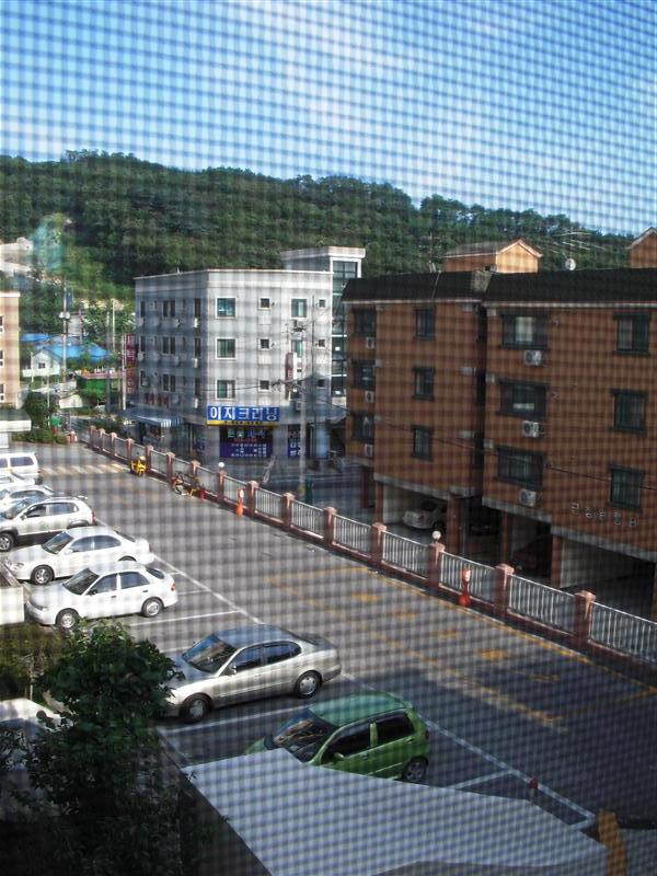 View of the street by our building from the fourth floor