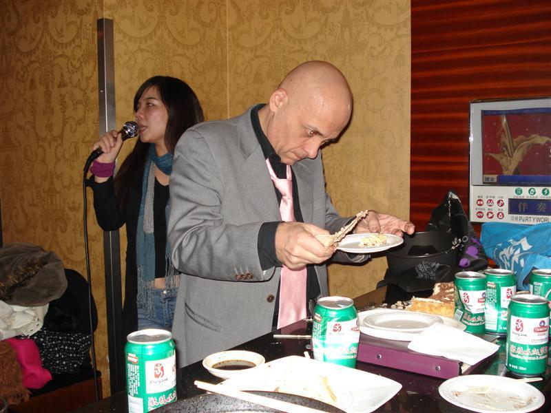 Pietro examining his cake at the KTV Night Guangzhou