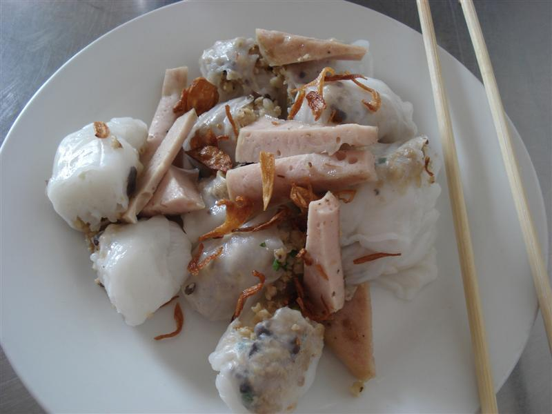 Weird dish of wobbly rice paper, nuts, and sausage