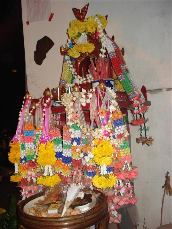 A small but very decorated spirit house