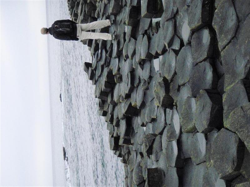 Standing looking out at the ocean on the Giants Causeway