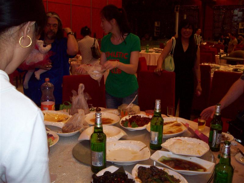 After the wedding guests were given bags to take home food, our table was rushed because we had lots of leftovers.