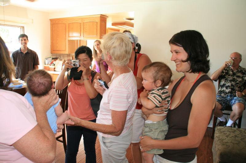 Gathering around the baby