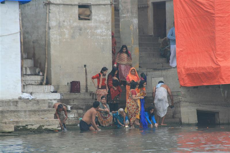 Family of Hindu devotees taking water from the Ganges