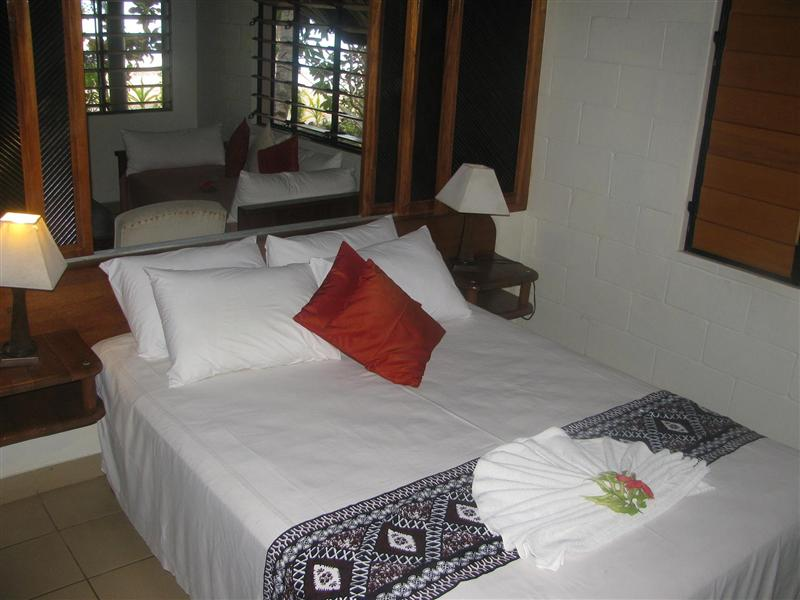 Our bed and living room in Bure No 10. Walu Beach Resort. Fiji