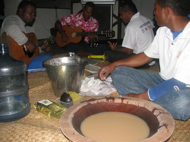 drinking kava, playing the guitar