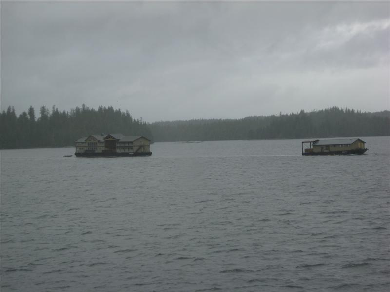 Two complete (!) houses being transported on the Inside Passage