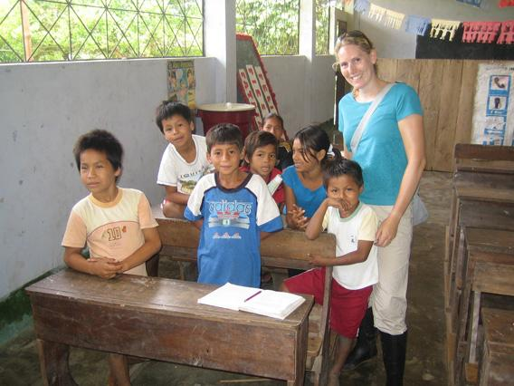 Corinne with local village school children
